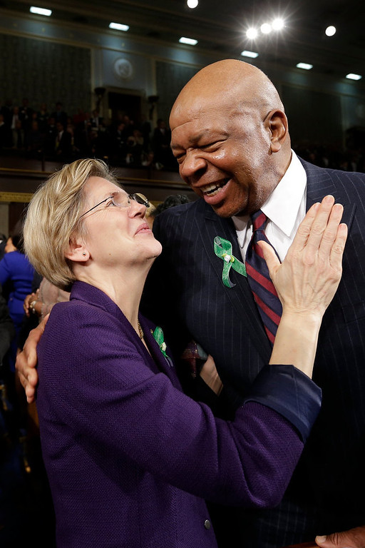 . Sen. Elizabeth Warren (D-MA) (L) talks with Rep. Elijah Cummings (D-MD) (R) on Capitol Hill on February 12, 2103 in Washington, D.C. Facing a divided Congress, Obama is expected to focus his speech on new initiatives designed to stimulate the U.S. economy. (Photo by Charles Dharapak-Pool/Getty Images)
