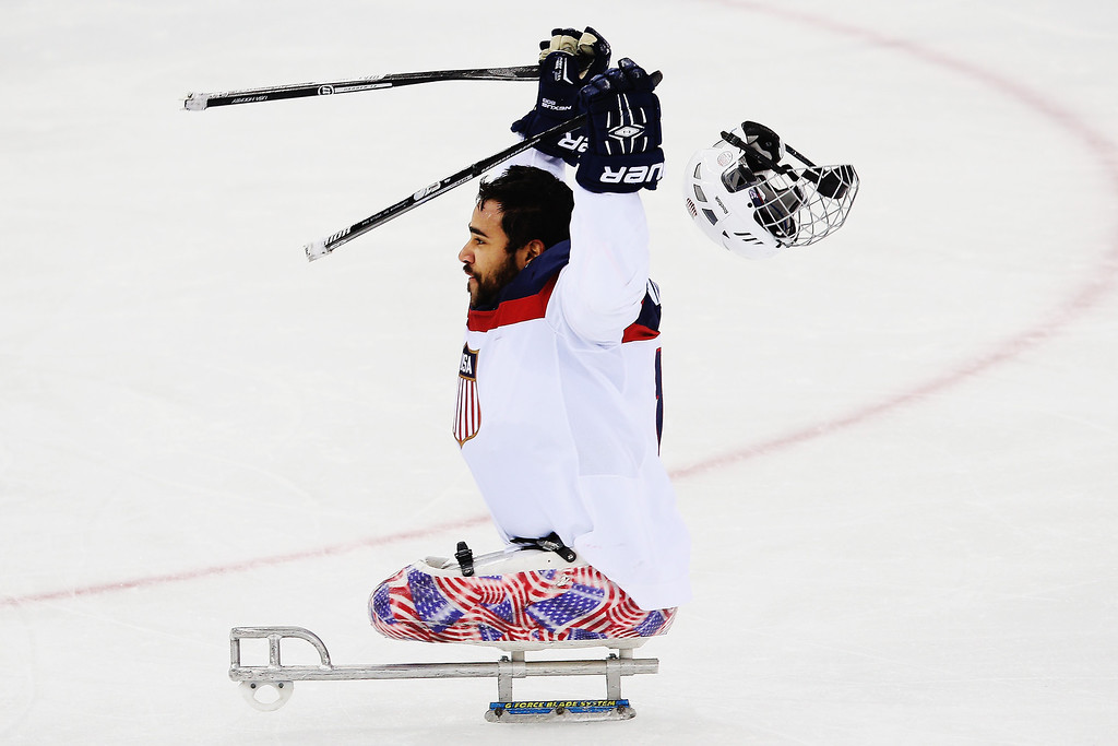 . Nikko Landeros of the USA celebrates after winning the ice sledge hockey gold medal game between the Russian Federation and the United States of America at the Shayba Arena during day eight of the 2014 Paralympic Winter Games on March 15, 2014 in Sochi, Russia.  (Photo by Hannah Peters/Getty Images)