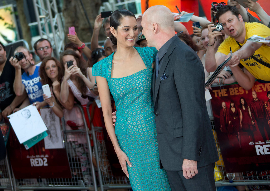 . Bruce Willis and wife Emma Hemming arrive on the red carpet for the European Premiere of Red 2, at a central London cinema, Monday, July 22, 2013. (Photo by Joel Ryan/Invision/AP)