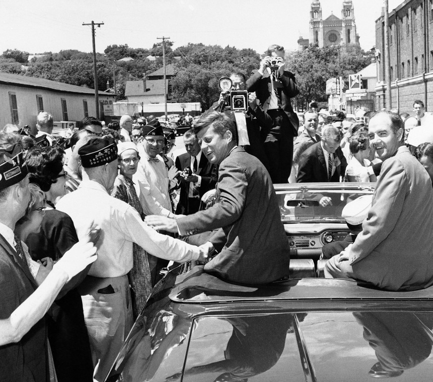 . George McGovern, then a congressman, joined Sen. Kennedy on the campaign trail in June 1960. Both went on to victory, Kennedy as president and McGovern as senator. Picture, they greet a crowd in Sioux Falls, S.D. Associated Press file