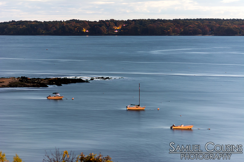 Boats moored in Casco Bay. This was taken at night.