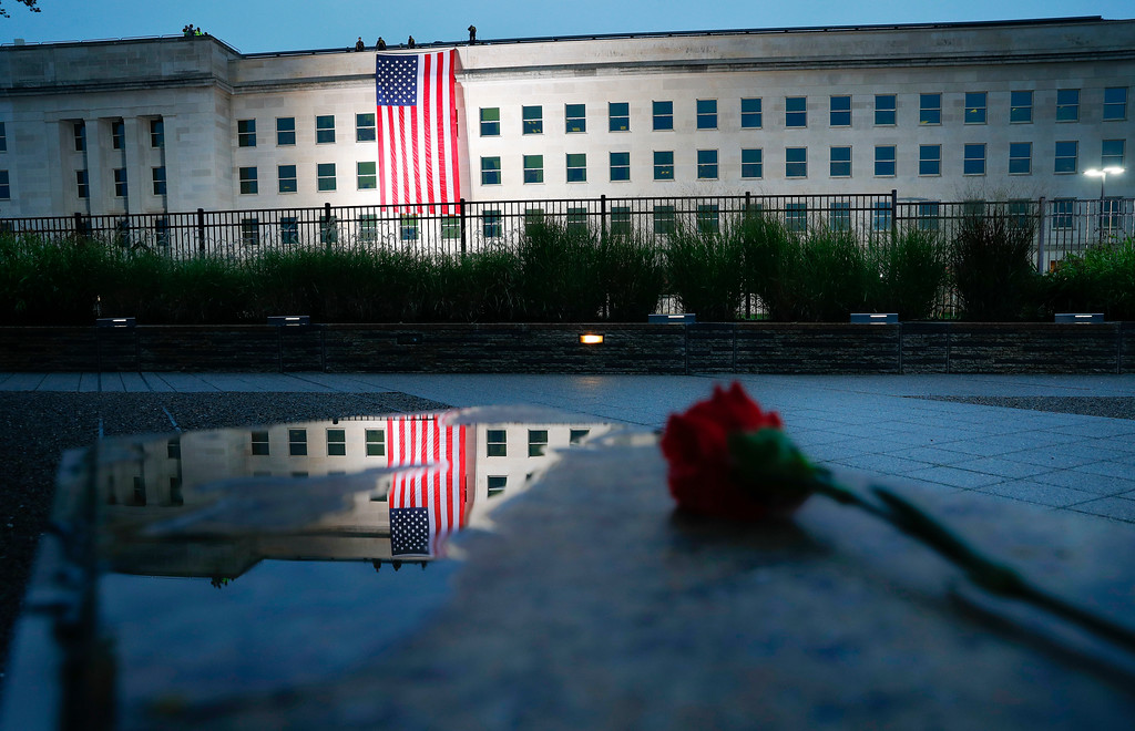. A U.S. flag is unfurled at sunrise on Tuesday, Sept. 11, 2018, at the Pentagon on the 17th anniversary of the Sept. 11, 2001, terrorist attacks. (AP Photo/Pablo Martinez Monsivais)