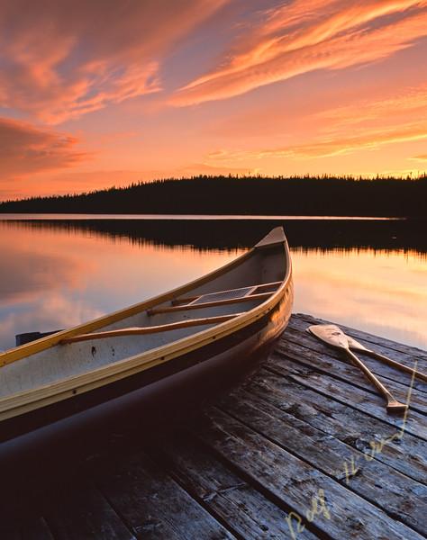 Canoe at sunset at Tuckamore Lake, Great Northern Peninsula, Viking Trail, Newfoundland, Canada