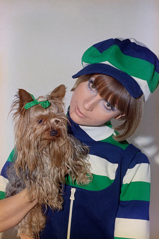 . Beret Fashioned from panels of contrasting colors with Dog is reminder of the Jackie Coogan Era and is a matching hat & dress outfit. (AP Photo/Marqueton)