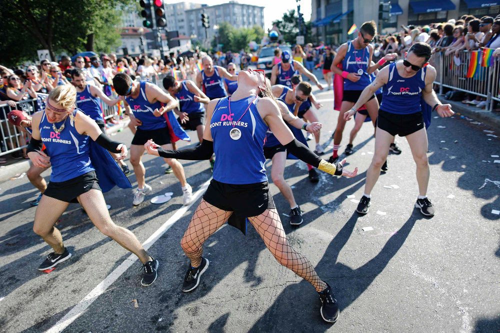 . Members of a running club do a dance routine as they take part in the gay-pride themed Capital Pride Parade in Washington, June 8, 2013. REUTERS/Jonathan Ernst