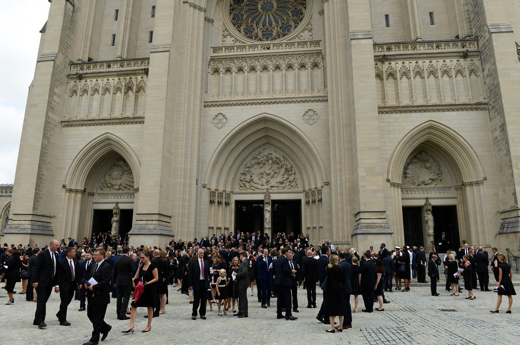 . People leave the Washington National Cathedral in Washington, Saturday, Sept. 1, 2018, following a memorial service for Sen. John McCain, R-Ariz. McCain died Aug. 25 from brain cancer at age 81. (AP Photo/Susan Walsh)