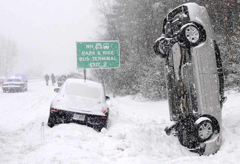 . This Feb. 1, 2011 photo shows a car that landed vertically into a snowbank after a multiple vehicle accident on Interstate 93 during a snow storm north of Salem, N.H. No one was injured. (AP Photo/The Eagle-Tribune, Tim Jean)