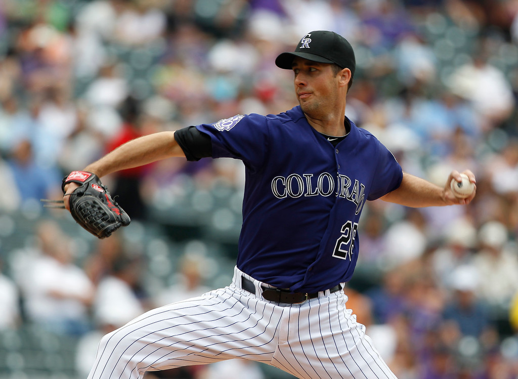 . Colorado Rockies starting pitcher Jeff Francis works against the Washington Nationals in the first inning of a baseball game in Denver on Thursday, June 13, 2013. (AP Photo/David Zalubowski)