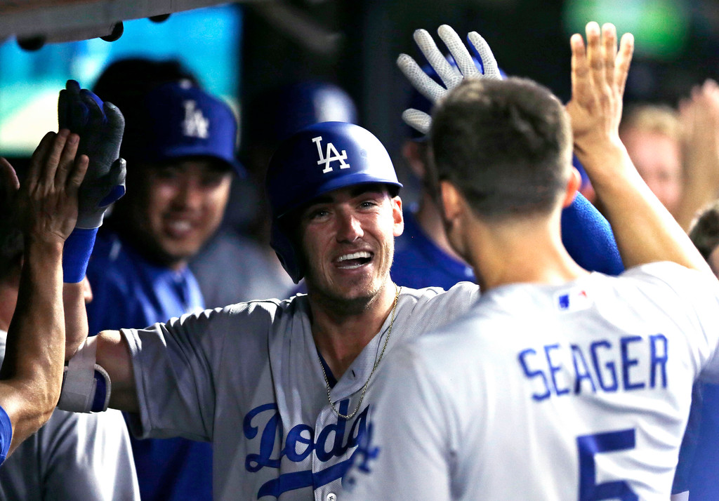 . Los Angeles Dodgers\' Cody Bellinger is congratulated by teammates after he hit a solo home run off Cleveland Indians relief pitcher Andrew Miller during the eighth inning of a baseball game, Tuesday, June 13, 2017, in Cleveland. (AP Photo/Tony Dejak)