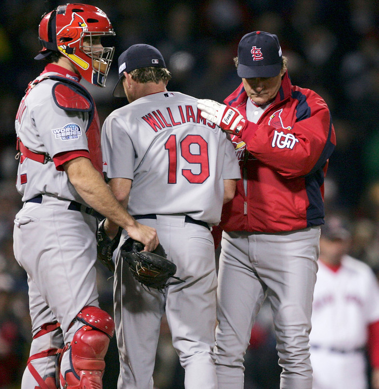 . St. Louis Cardinals manager Tony La Russa, right, takes pitcher Woody Williams out of the game in the third inning against the Boston Red Sox during Game 1 of the World Series Saturday, Oct. 23, 2004 in Boston. At left is catcher Mike Matheny. (AP Photo/Charles Krupa)