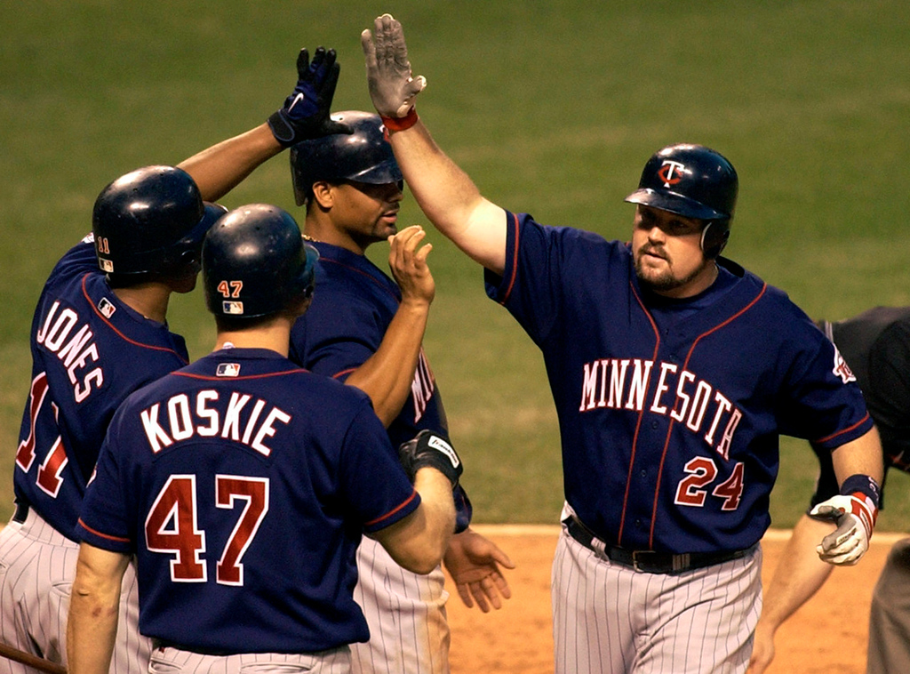 . Minnesota\'s Matt LeCroy  is congratulated by teammates after hitting a three-run home run in the sixth inning against the Indians at jacobs Fierld in Cleveland on Tuesday, Aug. 19, 2003.  (AP Photo/Tony Dejak)
