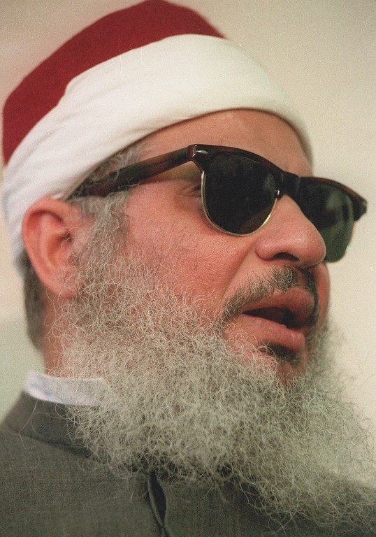 . FILE - This April 6, 1993 file photo shows Sheik Omar Abdel-Rahman in New York.   Kenneth McKoy of the Federal Correction Complex in Butner, N.C., said Abdel-Rahman died Saturday, Feb. 18, 2017, after a long battle with diabetes and coronary artery disease. Abdel-Rahman was sentenced to life in prison after his 1995 conviction for his advisory role in a plot to blow up landmarks, including the United Nations, and several bridges and tunnels.  (AP Photo/ Mark Lennihan, file)