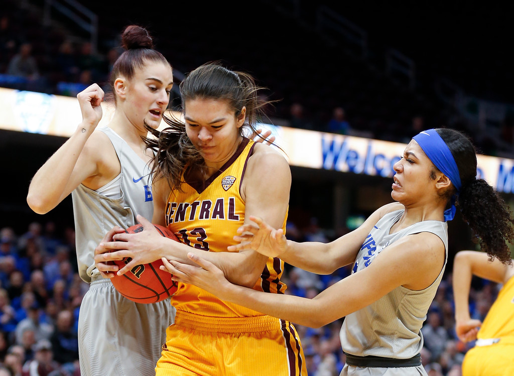 . Central Michigan forward Reyna Frost grabs a rebound between Buffalo forward Summer Hemphill, right, and Cassie Oursler during the first half of an NCAA college basketball game in the championship of the Mid-American Conference tournament Saturday, March 10, 2018, in Cleveland. (AP Photo/Ron Schwane)
