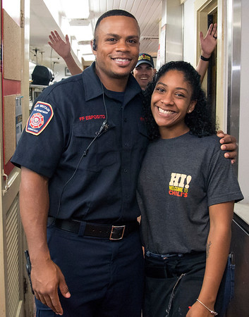 09/25/19 Wesley Bunnell | StaffrrTip a Firefighter took pace at Chili's in New Britain on Wednesday night. The event raised money for the city 's partnership with the community foundation regarding the new disaster relief program. Firefighter Esposito poses for a photo with a regular server from the restaurant.