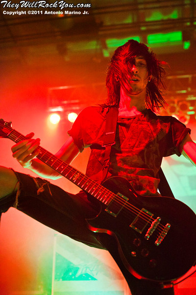 """Cameron Liddell of Asking Alexandria  performs on November 12, 2011 during the """"World War III"""" tour at the Mid-Hudson Civic Center in Poughkeepsie, NY"""