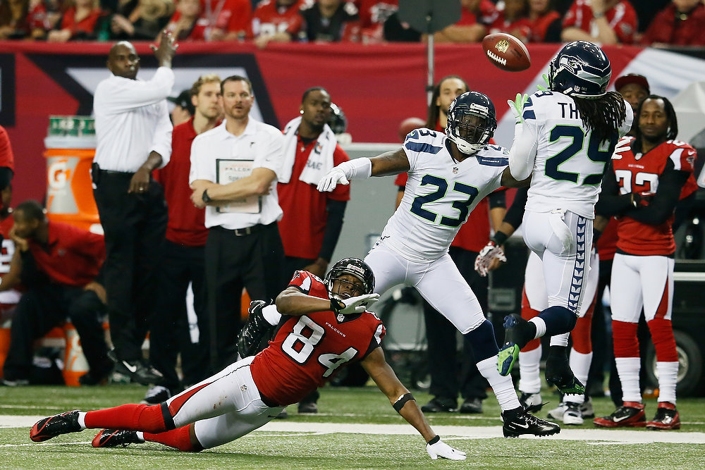 . Earl Thomas #29 of the Seattle Seahawks intercepts a pass intended for  Roddy White #84 of the Atlanta Falcons in the fourth quarter during the NFC Divisional Playoff Game at Georgia Dome on January 13, 2013 in Atlanta, Georgia.  (Photo by Kevin C. Cox/Getty Images)