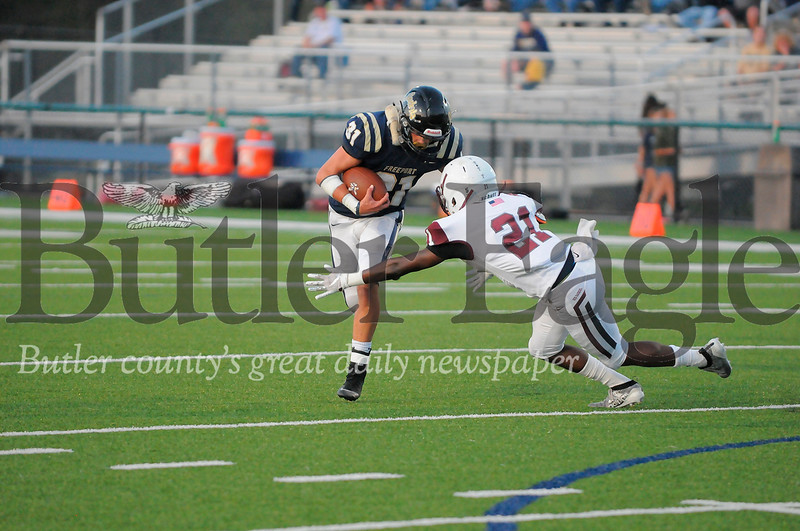 Freeport #31 Ricky Hunter runs the ball as Uniontown #21 Torry Robinson goes for the tackle during a game at Freeport Stadium on Friday September 20, 2019 (Jason Swanson photo)