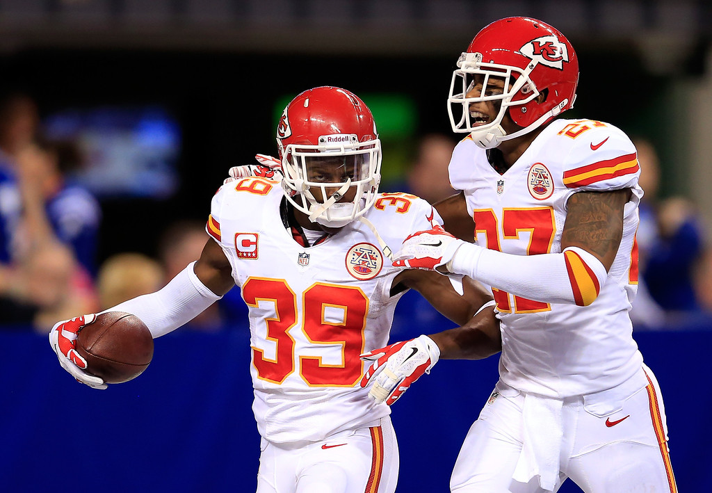 . INDIANAPOLIS, IN - JANUARY 04:  Defensive back Husain Abdullah #39 celebrates an interception with cornerback Sean Smith #27 of the Kansas City Chiefs against the Indianapolis Colts during a Wild Card Playoff game at Lucas Oil Stadium on January 4, 2014 in Indianapolis, Indiana.  (Photo by Rob Carr/Getty Images)
