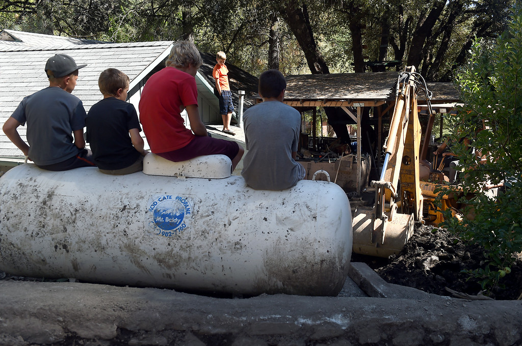 . Kids take a break from the clean-up from Sunday\'s storm in Mt. Baldy, CA, Tuesday, August 5, 2014. (Photo by Jennifer Cappuccio Maher/Inland Valley Daily Bulletin)