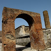 Roman arch in Pompeii, Italy March 2011...once was covered with tiles and artifacts, all moved to the museum in Naples.