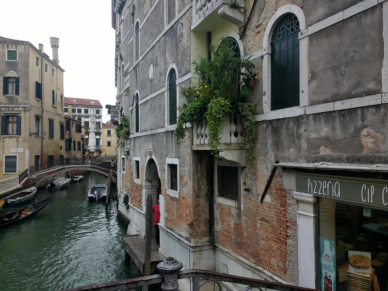 old building leading out to venice canal
