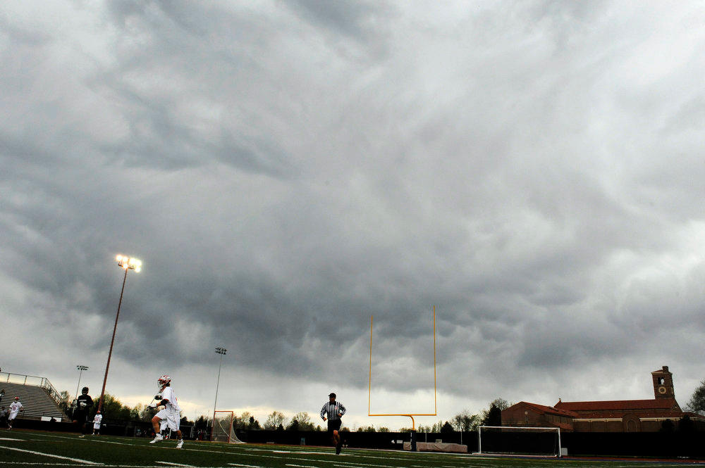 . Storm clouds hover over a CHSAA 5A boys lacrosse semifinal game between Regis Jesuit High School and Arapahoe at All City Stadium on May 15, 2013, in Denver, Colorado. Arapahoe won 13-5 to advance to the finals. (Photo by Daniel Petty/The Denver Post)