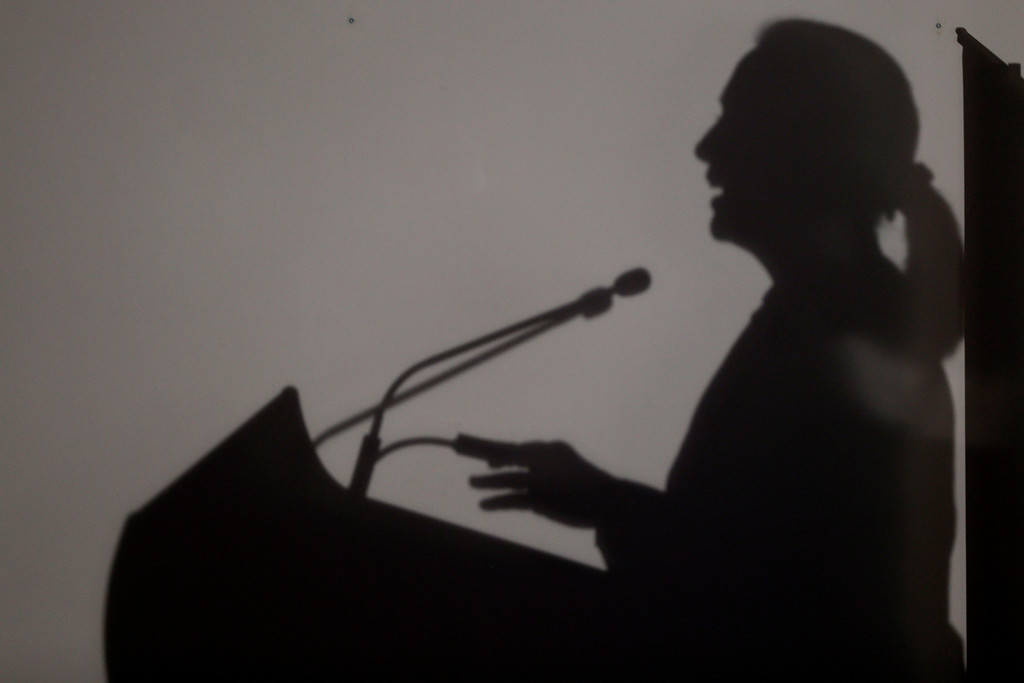 . The shadow of U.S. Secretary of State Hillary Rodham Clinton is seen as she speaks at University of Western Australia, Tuesday, Nov. 13, 2012, in Perth, Australia. (AP Photo/Matt Rourke, Pool)