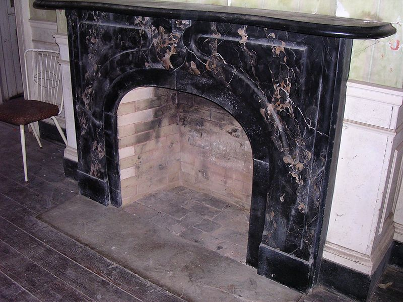 The fireplace in the front left parlor is made of black marble, and is much simpler than those in the main parlors. This is a more intimate space than the rooms on the right, perhaps a place for the family to gather, or for the ladies to retire to after dinner.
