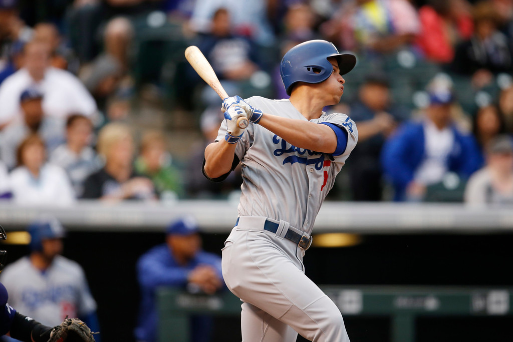 . Los Angeles Dodgers\' Corey Seager follows the flight of his single off Colorado Rockies starting pitcher Tyler Chatwood in the first inning of a baseball game Saturday, April 23, 2016, in Denver. (AP Photo/David Zalubowski)