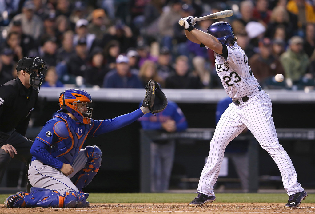 . Charlie Culberson #23 of the Colorado Rockies is hit by a pitch by starting pitcher Bartolo Colon #40 of the New York Mets in the fourth inning at Coors Field on May 1, 2014 in Denver, Colorado.  (Photo by Doug Pensinger/Getty Images)