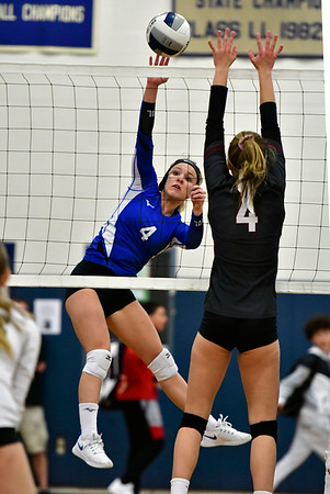 11/8/2018 Mike Orazzi | Staff Bristol Eastern High School's Olivia Beaudoin (4) and Farmington High School's Olivia Klinzmann (4) during the Class L Second Round State Girls Volleyball Tournament in Bristol Thursday night.