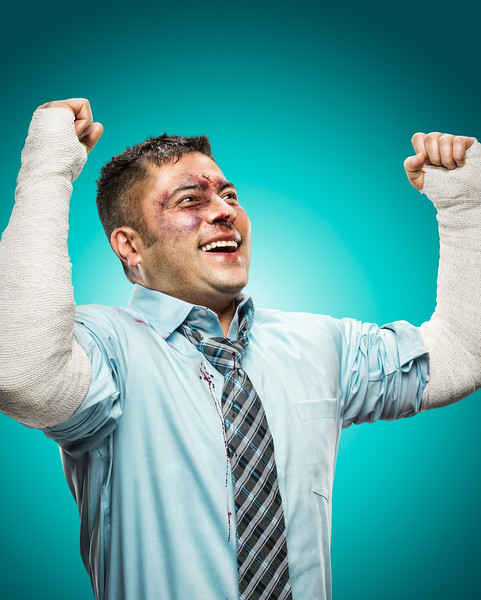 Portrait of a man excited about his broken arms