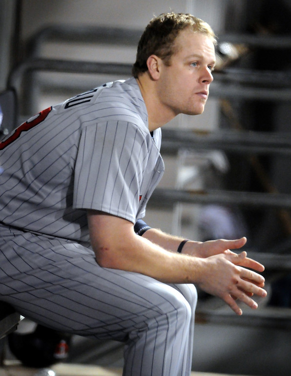 . The Twins\' Justin Morneau watches from the dugout during their 1-0 loss to the Chicago White Sox in their one-game playoff at U.S. Cellular Field on September 30, 2008.  (Pioneer Press: John Doman)