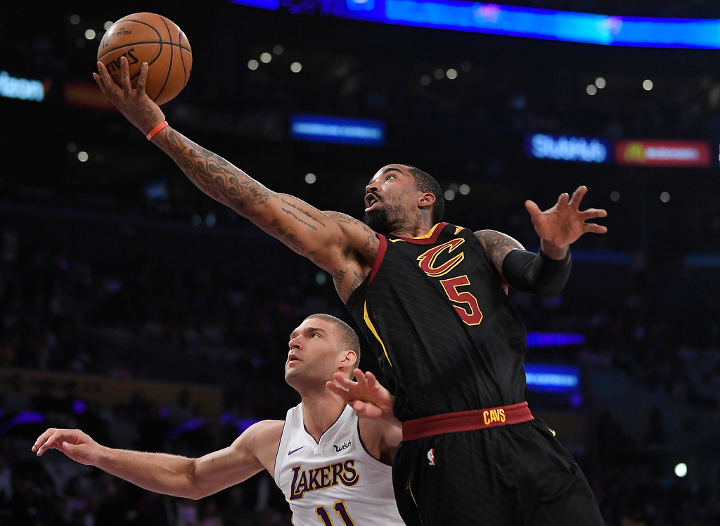 . Cleveland Cavaliers guard JR Smith, right, shoots as Los Angeles Lakers center Brook Lopez defends during the first half of an NBA basketball game, Sunday, March 11, 2018, in Los Angeles. (AP Photo/Mark J. Terrill)