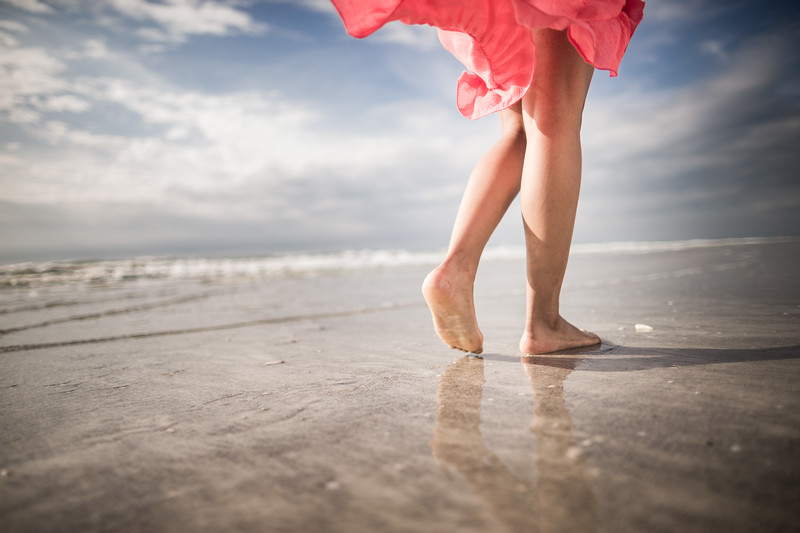 Legs walking on the beach