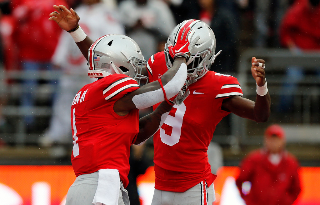 . Ohio State receiver Johnnie Dixon, left, celebrates his touchdown against Rutgers with teammate Binjimen Victor during the first half of an NCAA college football game Saturday, Sept. 8, 2018, in Columbus, Ohio. (AP Photo/Jay LaPrete)
