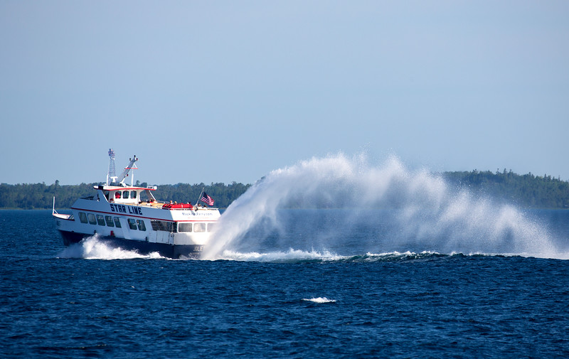 The Star Line Ferry service blasts past us.