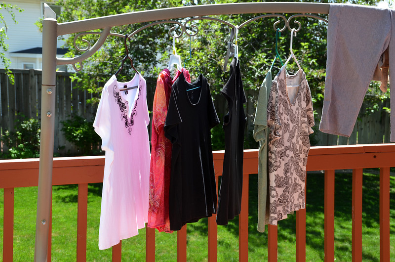 2012-5-5 ––– Lisa loves to dry her clothes outside. She loves how they are stiff once dry, but especially loves the smell. Now that it is warm enough, she will have lots of clothing out to dry in the backyard.