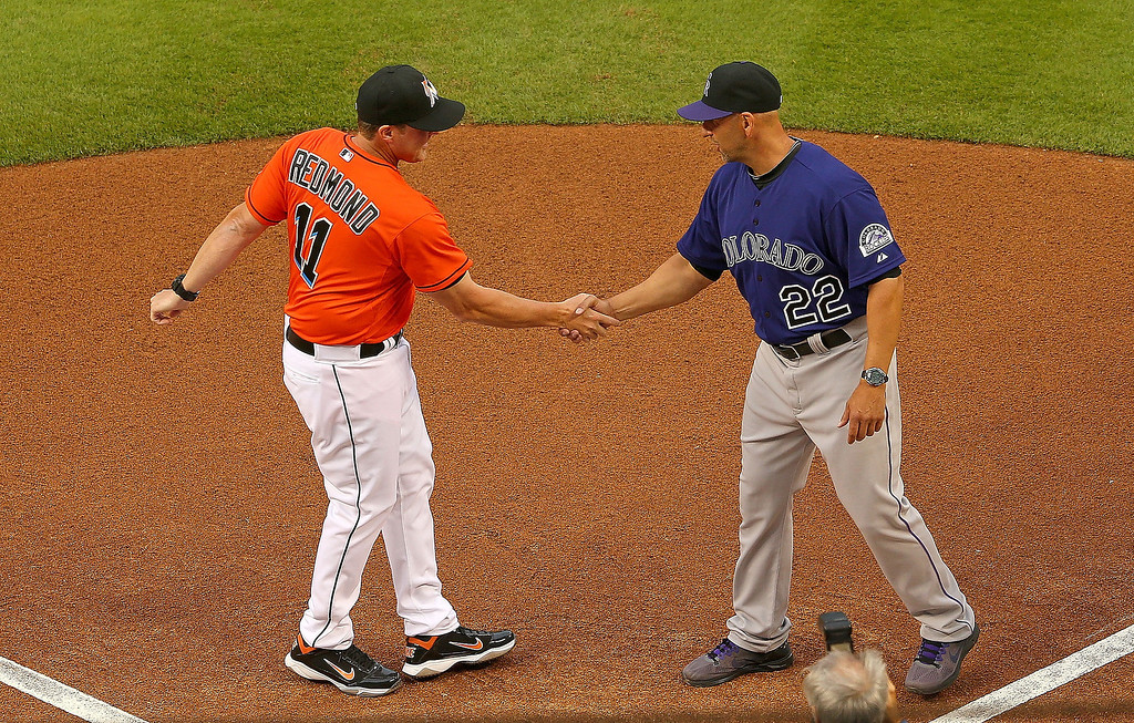 . Head coach Mike Redmond #11 of the Miami Marlins and head coach Walt Weiss #22 of the Colorado Rockies shake hands during Opening Day  at Marlins Park on March 31, 2014 in Miami, Florida.  (Photo by Mike Ehrmann/Getty Images)