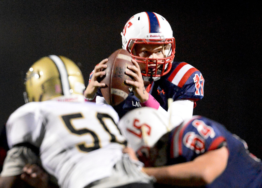 . La Salle\'s quarterback Will Plyburn prepares to pass as they play Bishop Montgomery during Friday night\'s football game at La Salle High School in Pasadena, October 25, 2013.  (Photo by Sarah Reingewirtz/Pasadena Star-News)