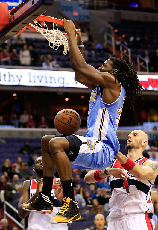 . Kenneth Faried #35 of the Denver Nuggets dunks the ball in front of Marcin Gortat #4 of the Washington Wizards for the go head score during the Nuggets a 75-74 win at Verizon Center on December 9, 2013 in Washington, DC.  (Photo by Rob Carr/Getty Images)