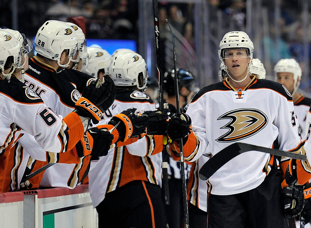 . Anaheim Ducks left wing Brad Winchester, right, celebrates a goal with his teammates in the first period of an NHL preseason hockey game against the Colorado Avalanche Monday, Sept. 22, 2014 in Denver. (AP Photo/Chris Schneider)