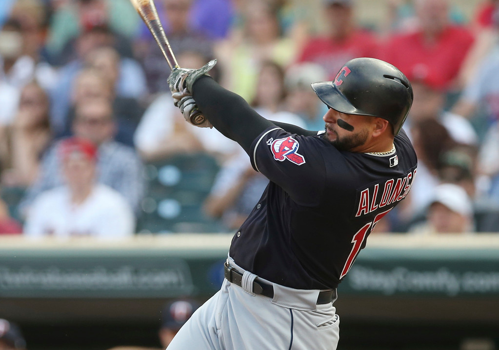 . Cleveland Indians\' Yonder Alonso follows through on an RBI single off Minnesota Twins pitcher Jake Odorizzi during the first inning of a baseball game Thursday, May 31, 2018, in Minneapolis. (AP Photo/Jim Mone)