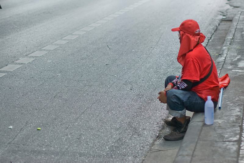 Man resting on a side road during Red Shirt Protest - Thailand