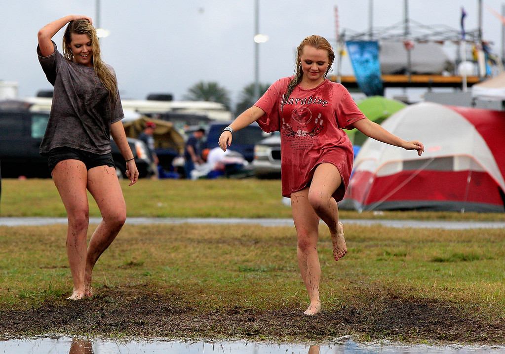 . Fans play in the infield during a rain delay for the NASCAR Sprint Cup Series Daytona 500 at Daytona International Speedway on February 23, 2014 in Daytona Beach, Florida.  (Photo by Sean Gardner/Getty Images)