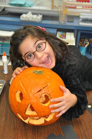 First Graders Practice Estimation Skills  with Halloween Pumpkins