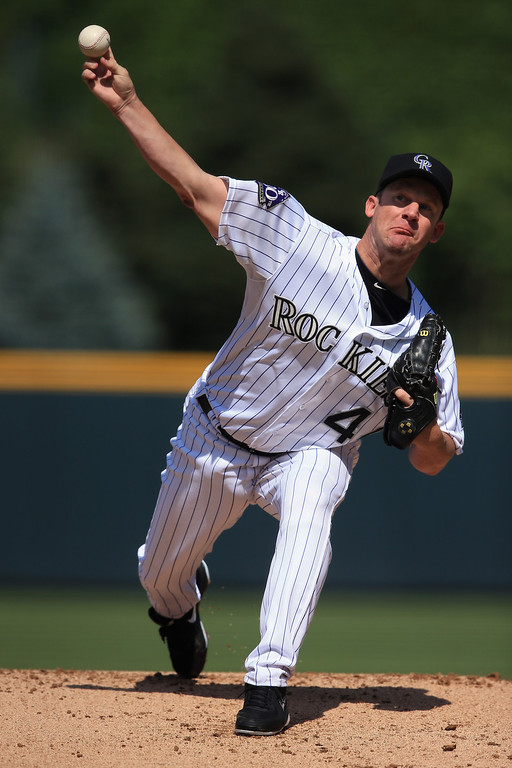 . Starting pitcher Roy Oswalt #44 of the Colorado Rockies delivers against the St. Louis Cardinals at Coors Field on September 19, 2013 in Denver, Colorado.  (Photo by Doug Pensinger/Getty Images)