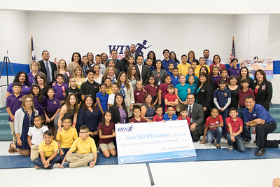 WIN Academy W.K. Kellogg Foundation check presentation