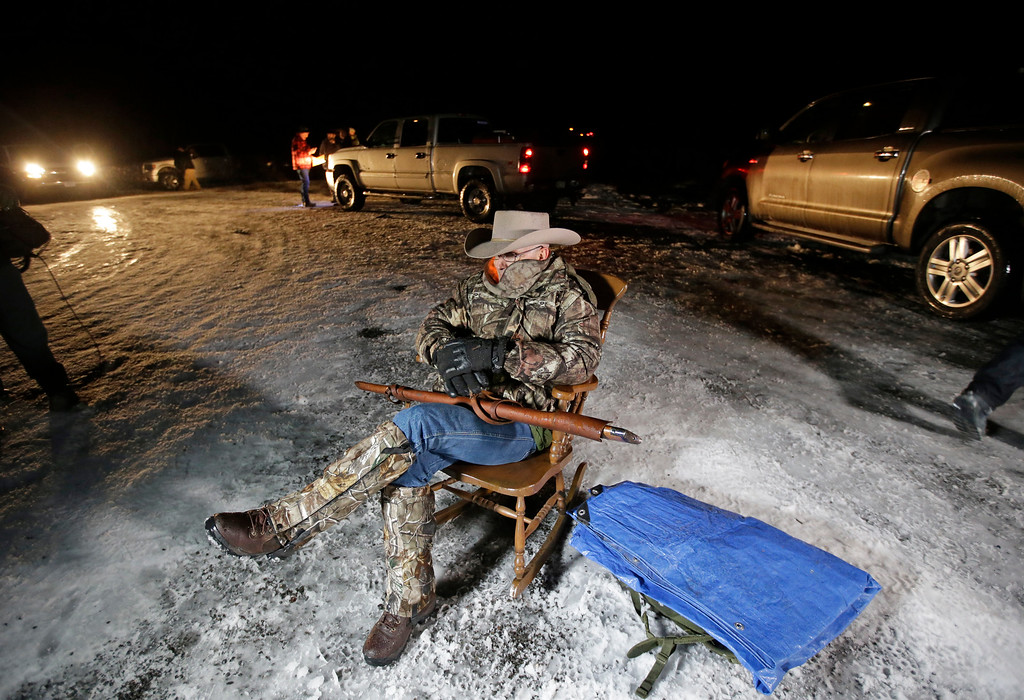 . Arizona rancher LaVoy Finicum, holds as he guards the Malheur National Wildlife Refuge, Tuesday, Jan. 5, 2016, near Burns, Ore. Ammon Bundy, the leader of a small, armed group that is occupying a remote national wildlife preserve in Oregon said Tuesday that they will go home when a plan is in place to turn over management of federal lands to locals. (AP photo/Rick Bowmer)