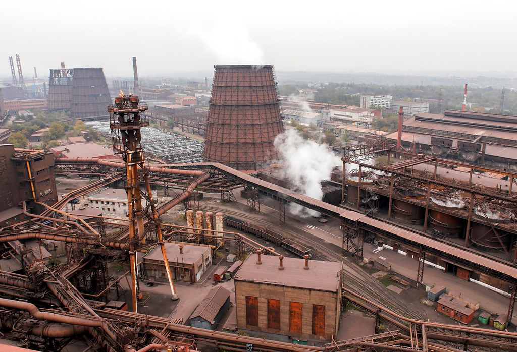 . Vapour rises from towers at the Zaporizhstal steel plant, owned and operated by Metinvest BV at their site in Zaporizhzhya, Ukraine, on Tuesday, Oct. 15, 2013. Metinvest BV, Ukraine\'s largest steelmaker, last year acquired 49.9% in steelmaker Zaporizhstal a manufacturer of semi-finished steel products, including hot and cold-rolled plates and coils. Photographer: Vincent Mundy/Bloomberg